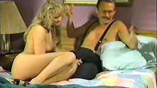 Big breasted lusty brunette gives nice blowjob to her lover in hotel room