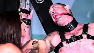 Horny brunette mistress pegs her slave