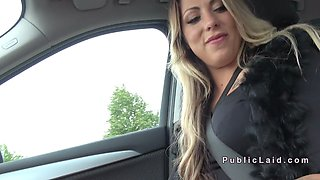 German blonde bangs in public in car