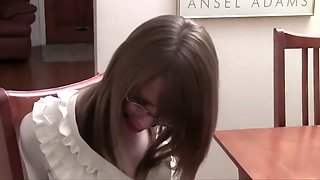 Secretary with glasses bound to a chair and ballgagged