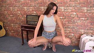 Leggy girl in short jeans skirt Britney shows pussy upskirt