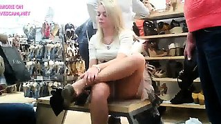 upskirt of a cute sitting girl in a shoe store