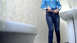 Blonde young babe in the toilet room filmed nude from behind