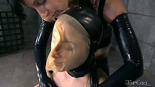 Tied up brunette harlot gets her pussy finger fucked and punished