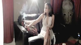 Sensual brunette is a pro at smoking and teasing in front o