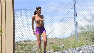 Outdoor teasing by slutty young gal