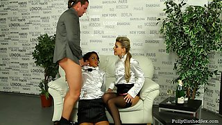 Ladies in nylons and elegant satin blouses share a dick