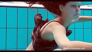 playful nata swims in a pool in nice dress and fleshing her nice booty