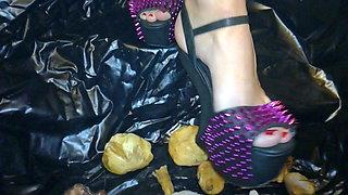 Lady L crush  mushrooms with extreme gaga high heels.