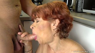 Ugly mature redhead Donatella gives a good BJ in return for cuni