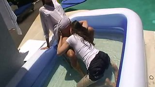 Pregnant beauty has hot lesbian sex in the pool