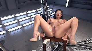Soft asian takes machine in the ass