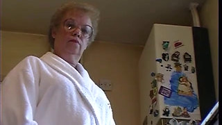 British granny strips in her kitchen