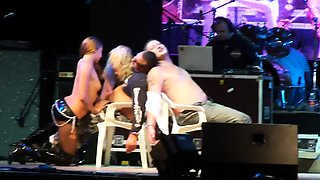 Sensuous blonde babes put on a wonderful strip show on stage