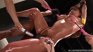 kaori maeda is masturbated by two guys while she's oiled up