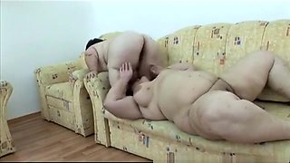Lustful plumper engaging in steamy lesbian action with a horny midget