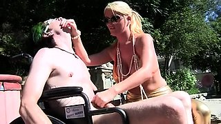 Big breasted blonde mom jerks off a young cock by the pool