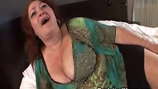 Busty MILF gets a big black cock in anal action